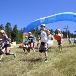 Custom-branded Dairy Farmers of Canada Inflatable Arch, placed at the end of a race, with runners coming through it.