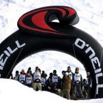 Custom-branded O'Neil Inflatable Arch, placed at the beginning or end of a race on a ski hill with people close by.